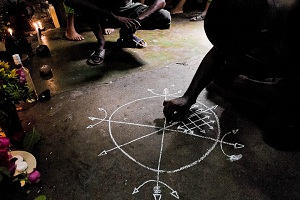 Spellcaster drawing a magic circle during a ritual